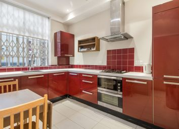 Fitzroy Mews, London W1T. 4 bed mews house