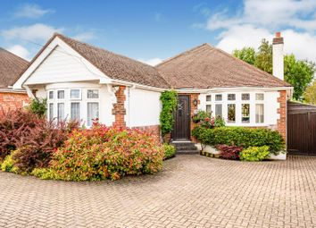 Warenne Road, Fetcham, Leatherhead KT22. 4 bed detached bungalow