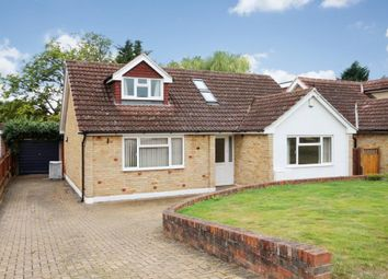 The Garstons, Bookham, Leatherhead KT23. 4 bed detached bungalow