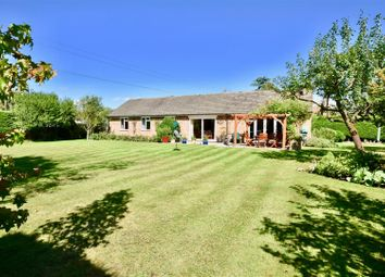 Bushey Shaw, Ashtead KT21. 4 bed detached bungalow