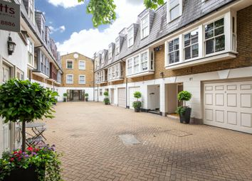 Thumbnail 3 bed mews house to rent in St Catherines Mews, London