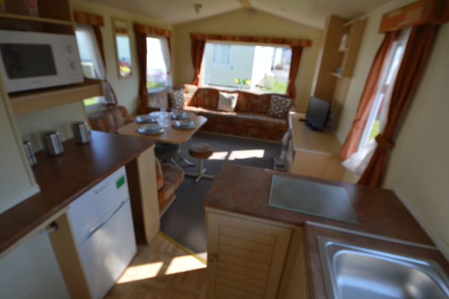 The Classically Designed Lounge Area Is Spacious And Also Features A Cosy Sofa Bed To Sleep A Further 2 People.This Holiday Home Boasts Just The Right Combination Of Both Functionality And Style When It Comes To The Kitchen.
