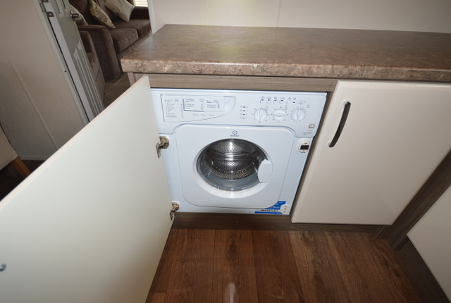 Hob And Washing Machine. Completed With An American Style Fridge-Freezer With Ice Making Facility.
