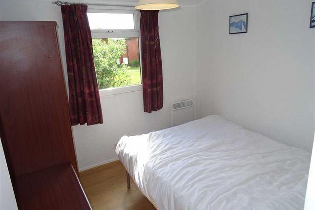Bedroom One: of Chalet, 61, Erw Porthor, Tywyn, Gwynedd LL36