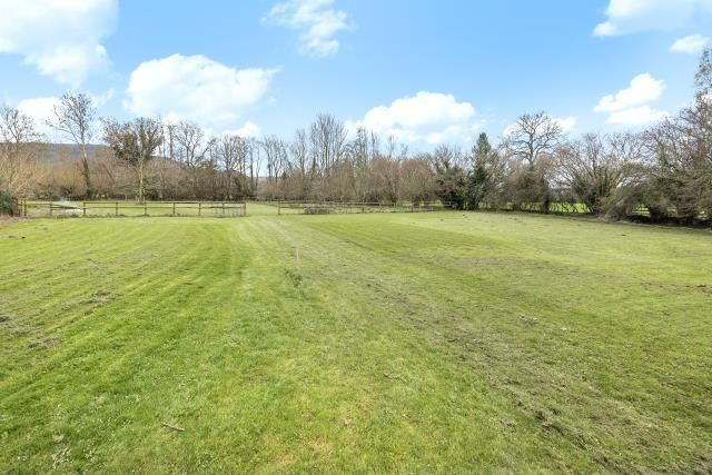 Level Field At The Rear Of The Cottage