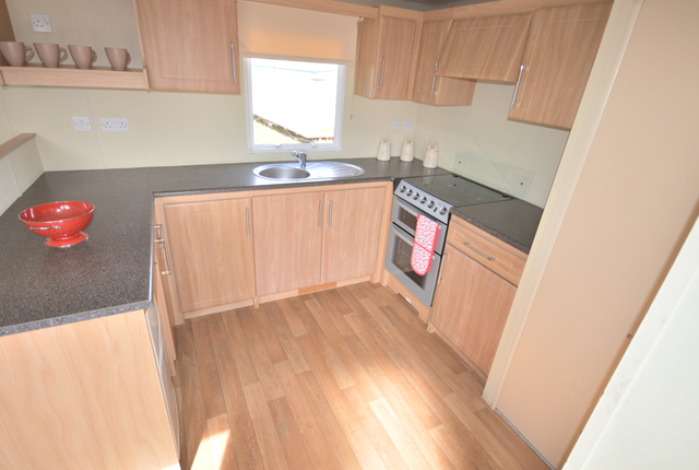 The Delta Denbigh Boasts A Stunning Lounge Area With Ample Space For All The Family To Gather Together At The End Of A Long Day. The Kitchen Is Often The Hub Of Every Holiday Home And The Delta Denbigh Is No Exception With Plenty Of Work Top Space And Lots Of Storage. Making The Best Possible Use Of Space