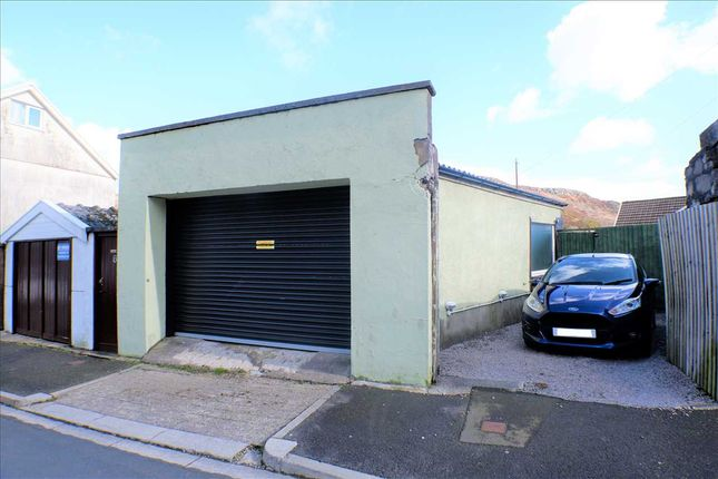 Garage With Off Road Parking