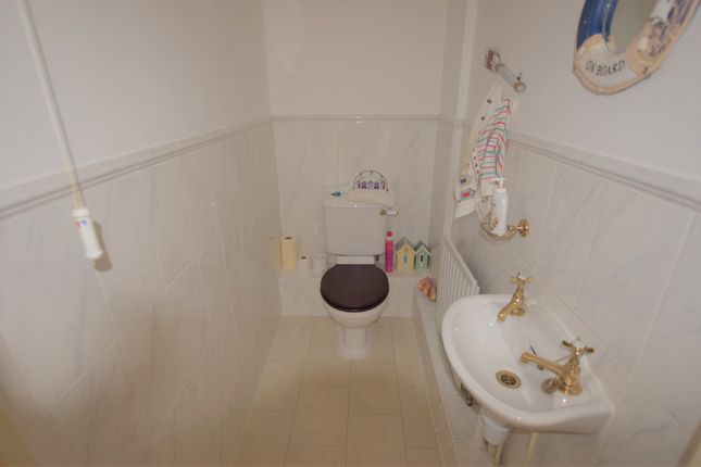 Downstairs WC of Admiralty Way, Eastbourne BN23