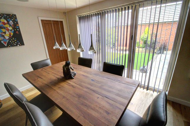 Dining Room With Bi-Fold Doors