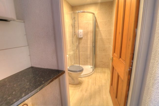 Utility Area To Shower Room