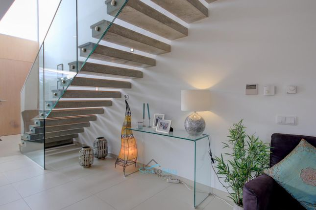Floating Concrete And Wood Stairs