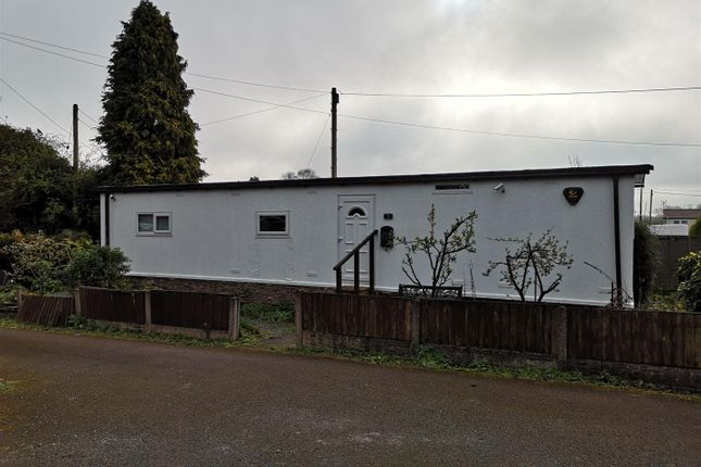Front 2.Png of Orchard Caravan Site, Hopton ST18