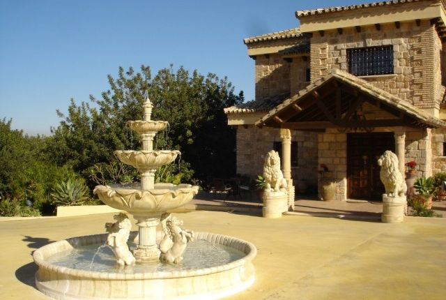 Fountain And House