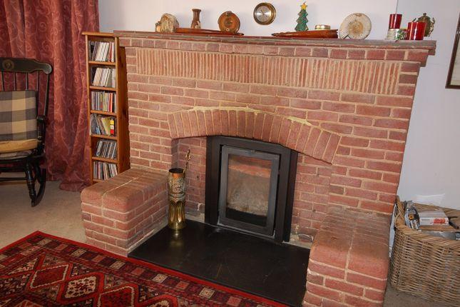 Fireplace of Higgs Lane, Bagshot GU19