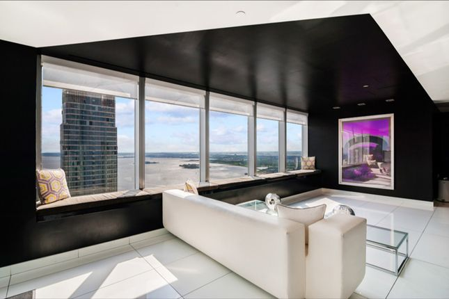 Living Room With City And River Views At 123 Washington Street