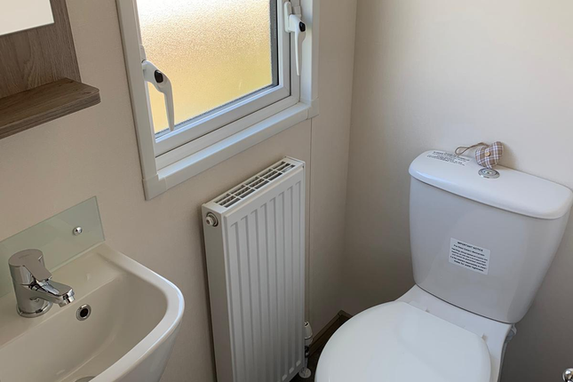 Family Sized Shower Room And A Separate Toilet.