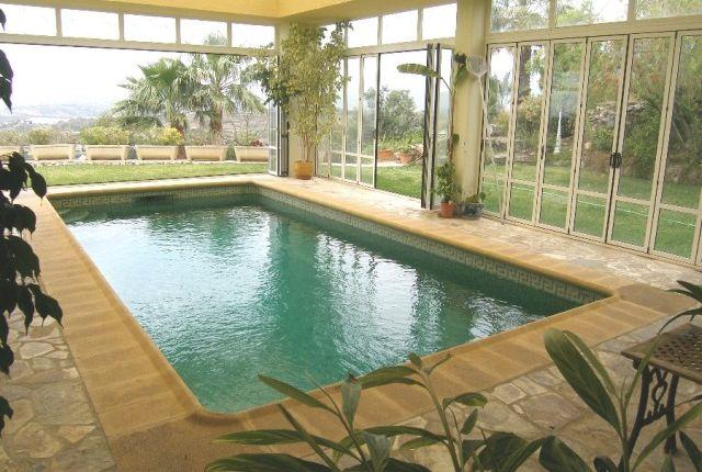 Indoor Pool And Gardens View