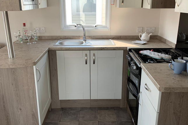 There Is Modern Fixtures And Fittings Throughout And A Very Spacious Kitchen That Offers A Integrated Fridge Freezer. As We Head Towards The Back Of The Holiday Home There Are 3 Spacious Bedrooms With Built In Wardrobes And Over Head Storage