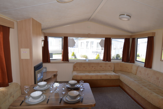 This Holiday Home Boasts A Galley Kitchen With All The Comforts From Home Including A Fridge Freezer And Oven. The Model Boasts A Compact