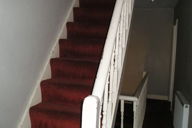 Spindled Staircase To First And Second Floor