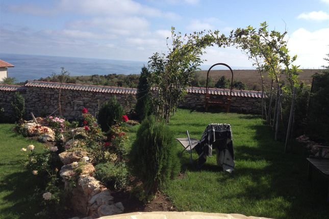 Garden And Sea Views From House