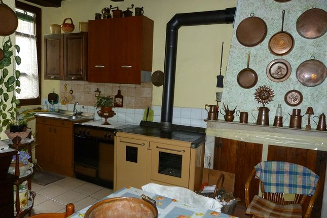 Kitchen With Wooden Stove