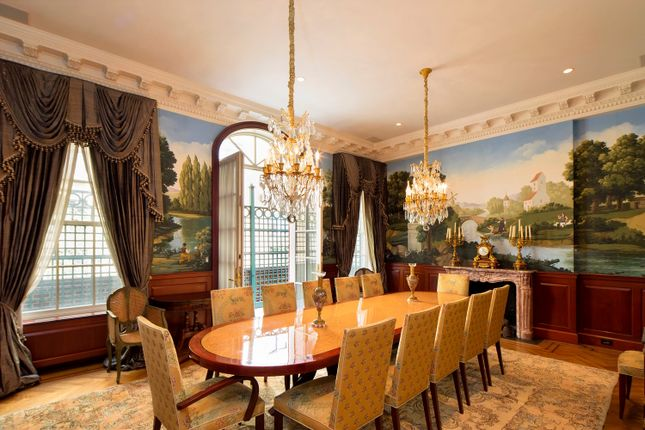 Elegant Dining Room With Wooden Floors, Fireplace And Original Features