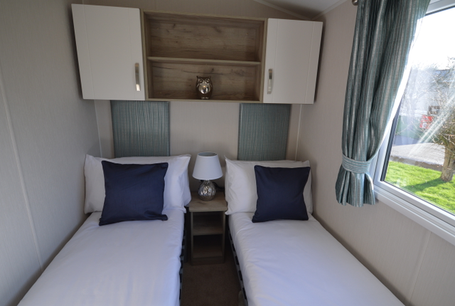 This Luxurious Holiday Home Features A Large Master Bedroom With A Mordernly Fitted En-Suite Bathroom