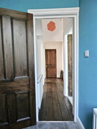 Wide Hall With Wood Flooring