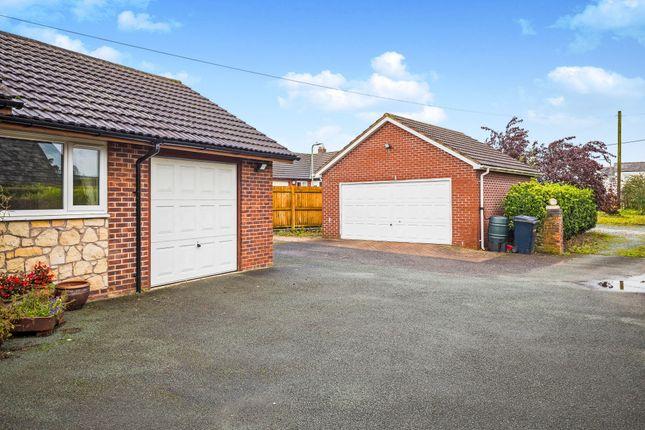 Triple Garaging of Trefonen Road, Morda, Oswestry, Shropshire SY10