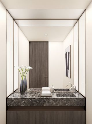 The Powder Rooms Feature Aquabrass Brushed-Nickel Faucets Atop Agora Stone Vanities