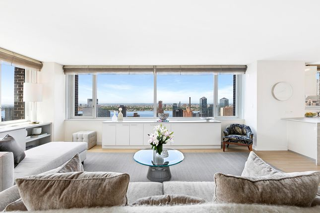 Living Room With City And River Views