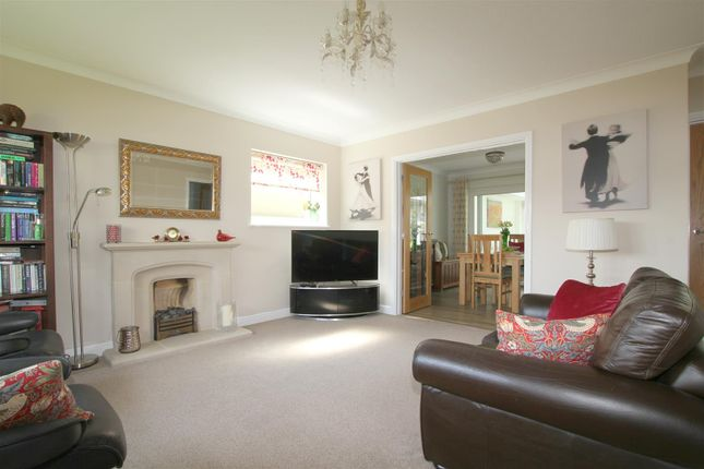 Sitting Room With Feature Fireplace And Open Plan