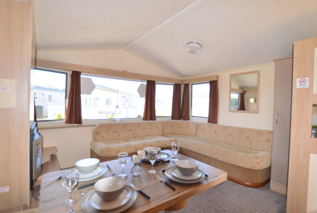Stay Cosy In The Winter Months By Nestling Down In The Plush Built-In Suite In The Beautifully Designed Living Area.