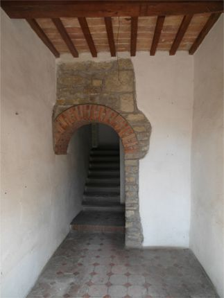 Stone Arch Leading To The Original Stone Staircase
