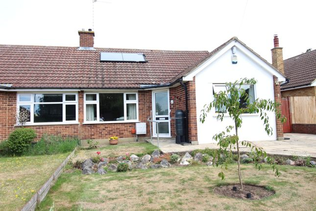 Front View of Mead Crescent, Bookham KT23