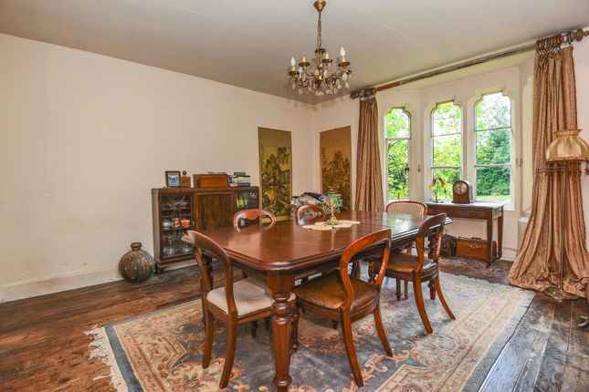 Dining Room With Wood Flooring