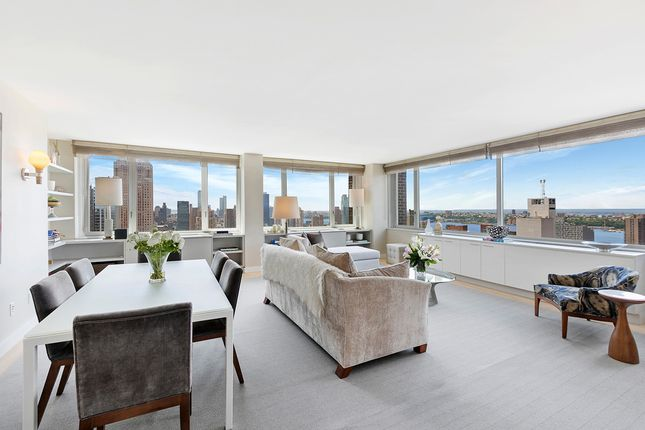 Open Plan Living Room And Dining Room With City Views