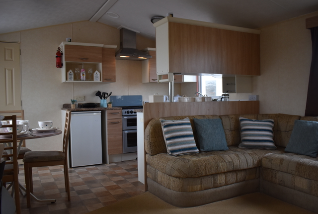 With Showers Next To Them.  There Is A Nice Sized Kitchen Area With Fridge