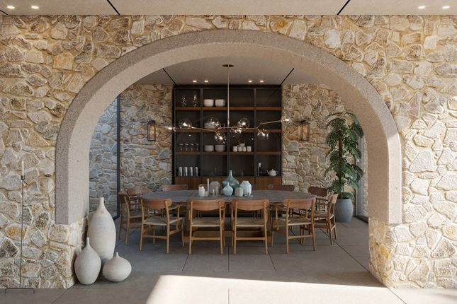 K Studio Dining Room With Stone Walls At Navarino Residences