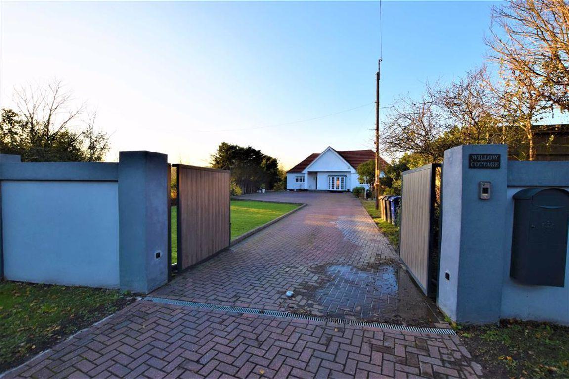 Property photo 1 of 24. Gated Driveway